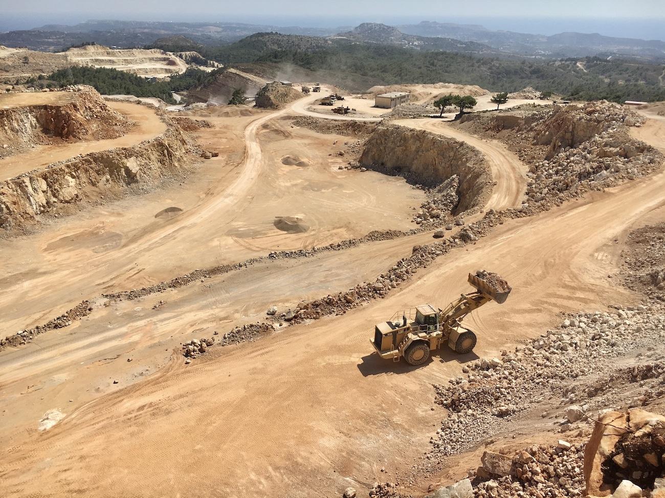 panoramic-quarry-with-a-buldozer